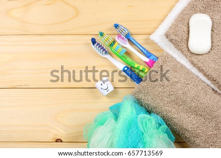 toothbrush tooth-brush with soap, bath towel and wisp of bast on wood background #657713569