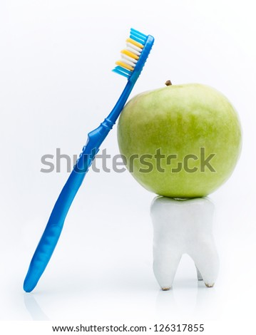Toothbrush with an apple on the tooth