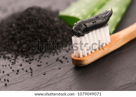 Toothbrush with black charcoal toothpaste with aloe vera Foto stock ©