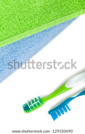 Toothbrushes and towels. View from above. Isolated on white background
