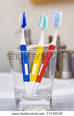 Toothbrushes in Glass