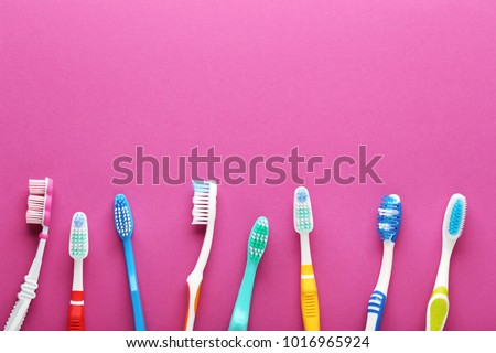 Toothbrushes on pink background