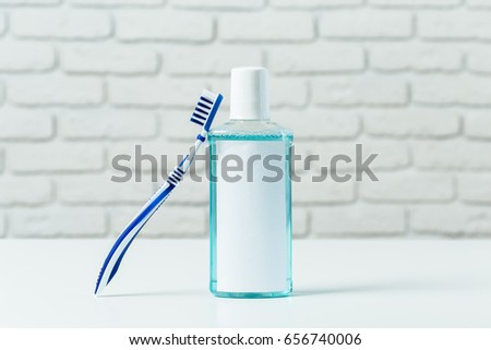 Toothbrushes on the table on light background