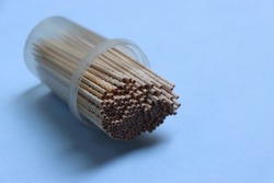 Toothpick in container, with copy space