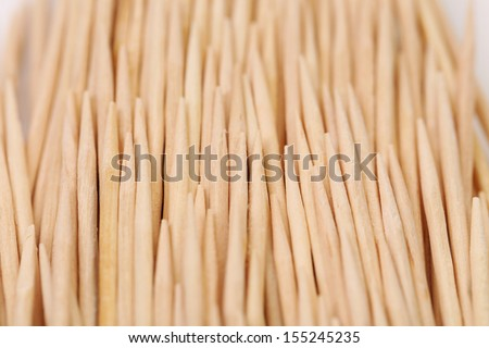 Toothpicks abstract composition. Vertically. Isolated on a white background.