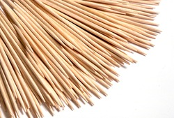 toothpicks arranged in a fan on a white background