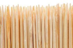 Toothpicks, many stacked in row, macro close-up