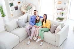 Top above high angle view full body photo of cheerful family happy positive smile sit sofa indoors laugh watch movie