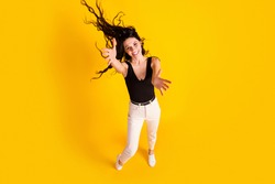 Top above high angle view full body photo of young excited girl fly air hair happy smile isolated over yellow color background