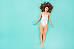 Top above high angle view full length photo of sleeping girl wearing white swimwear bikini laying on beach sunbathing want be tanned skin isolated over teal color background