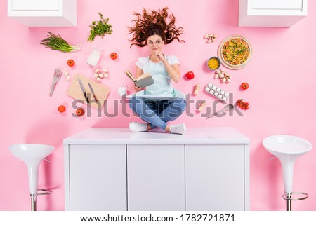 Top above high angle view full size photo minded housewife girl sit table read book think decide menu pizza recipe cook supper flat lay tomato eggs utensils isolated pastel color background Stock photo ©