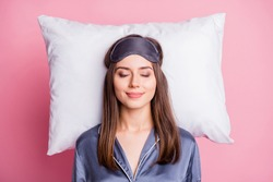 Top above high angle view photo portrait of satisfied woman sleeping on pillow isolated on pastel pink colored background