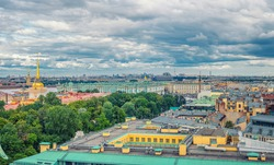Top aerial panoramic view of Saint Petersburg Leningrad city with Alexander Garden, State Hermitage Museum, Winter Palace, Neva river, golden spire of Admiralty building, dramatic sky, Russia