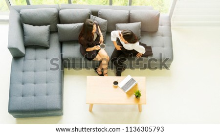 top aerial view business woman talk and sit on grey bench sofa with black coffee drinking ,teamwork brainstorm relaxing concept.