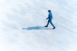 top aerial view businessman people walk on across pedestrian concrete with black silhouette shadow on ground, concept of social still life.