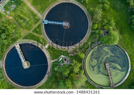Top aerial view of purification tanks of modern wastewater treatment plant