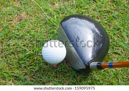 top and front view set driver on tee off play golf sport
