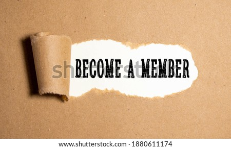 Top angle view of pen and notebook written with text BECOME A MEMBER. Business and education concept. Foto stock ©