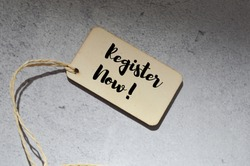 Top angle view of wooden board tag over grey background written with text REGISTER NOW!. Business and education concept.