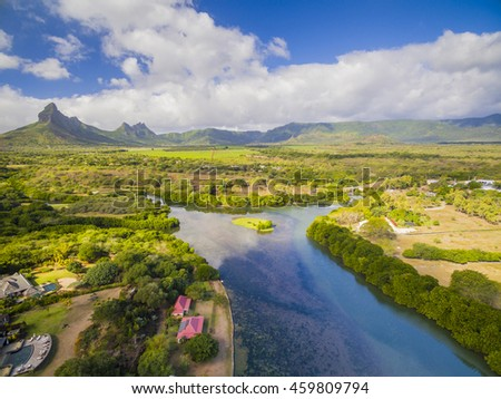 Top down aerial view of Black River Tamarin - Mauritius beach. Curepipe Black River Gorge National Park in background