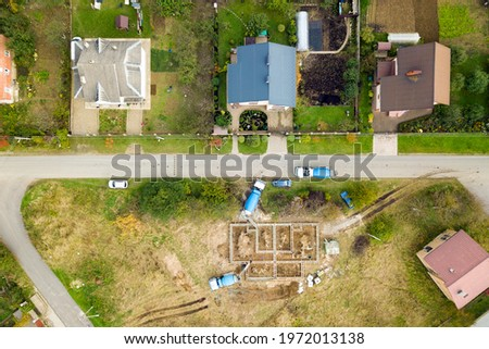 Top down aerial view of construction works of new house concrete foundation in rural residential area. Stock photo ©