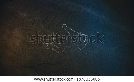 Top Down Shot of a Chalk Body Outline on the Pavement Symbolizing a Crime Scene Done on a Street at Night. Forensic science investigate Horrbile Murder with Death. Stock photo ©