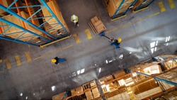 Top-Down View: In Warehouse People Working, Forklift Truck Operator Lifts Pallet with Cardboard Box. Logistics, Distribution Center with Products Ready for Global Shipment, Customer Delivery