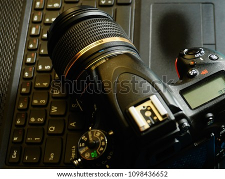 Top down view of a Camera and a laptop computer. Basic requirements for stock photography business.           #1098436652