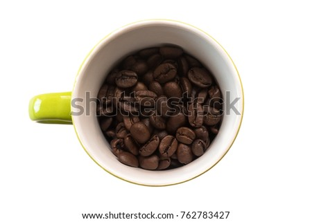 Top down view of a green mug, filled with natural coffee beans. Friendly and minimalist design. Isolated on white background