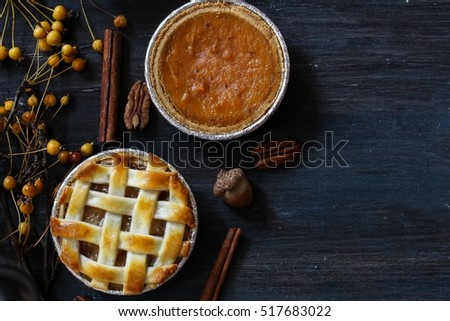 Top down view of Mini apple  and Pecan pie tart on wooden background / Thanksgiving Desserts