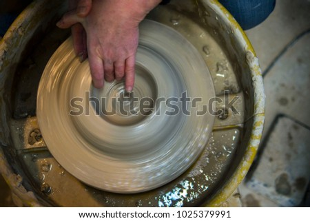 Top down view of pottery clay throwing wheel spinning motion art artist ceramic