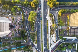 Top down view of road traffic in the heart of Jakarta business district along the Sudirman avenue in Indonesia capital city in Southeast Asia
