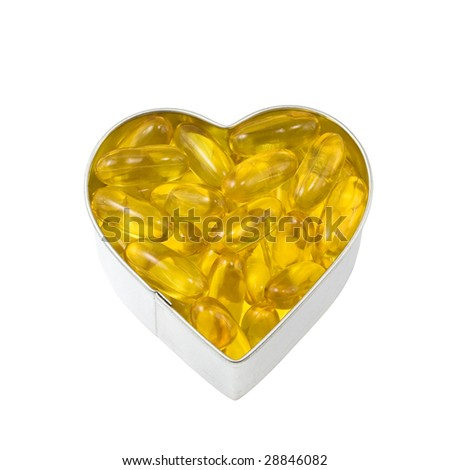 top down view of silver heart filled with salmon oil