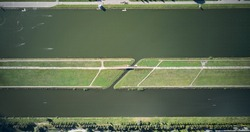 Top down view of the rowing canal and boats sculling through the water