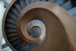 Top down view of the spiral staircase with wooden handle