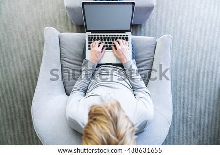 Top down view of young blond person typing on laptop computer #488631655