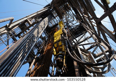 Top Drive System (TDS) and Derrick of Oil Drilling Rig