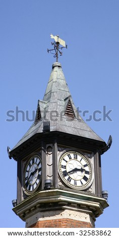top of a clock tower showing two faces