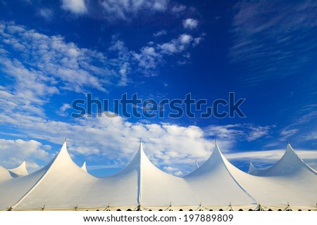 Top of a large event tent against a blue sky in Stowe, Vermont, USA #197889809