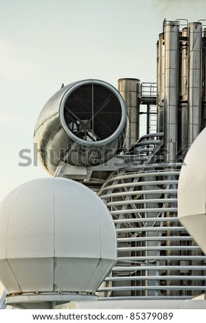 Top of cruise ship showing stacks and mechanical