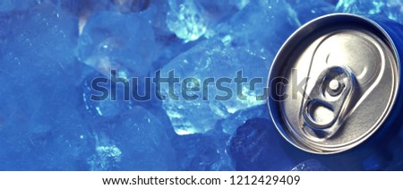 top of drink can iced submerged in frost ice, metal aluminum beverage.