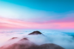 Top of Khao Lon Hills wrapped with morning cloud before sunrise from Phatthalung, Southern Province of Thailand