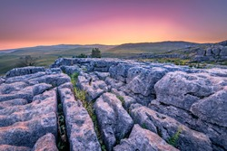 Top of Malham Cove showing the Clints and Grykes in the limestone. Harry Potter and The Deathly Hollows were filmed around Malham