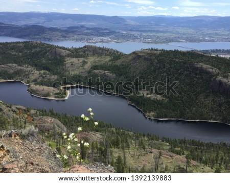 Top of McDougall hiking trail overlooking Rose Valley Lake and Okanagan Lake near Kelowna, British Columbia, Canada