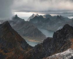 top of Mount Munken above fjords  under a stormy sky  on the Lofoten Islands in Polar Norway