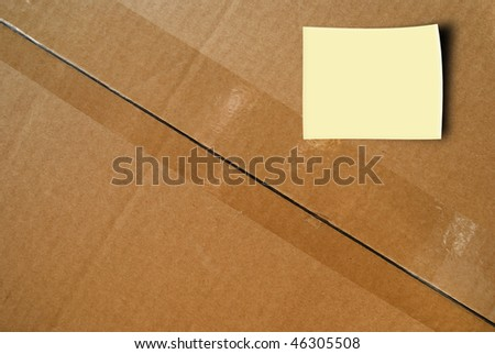 Top of Sealed Cardboard Box with yellow sticker.