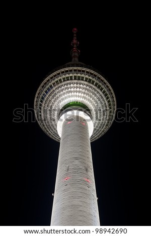 Top of the famous TV tower in Berlin at night - stock photo