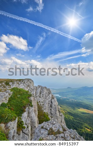 top of the mountain on the background of the cloudy sky. natural composition