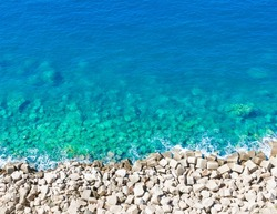 top of view limpid water on gravel beach isole tremiti italy