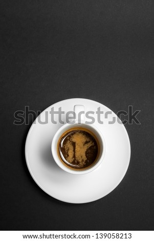 top of view of white cup of espresso coffee on grey background